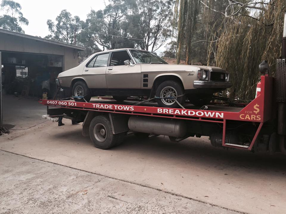 A picture of a silver Holden GTS on the Bent and Broke Towing truck