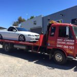 A picture of a white VZ SS ute on the Bent and Broke Towing truck