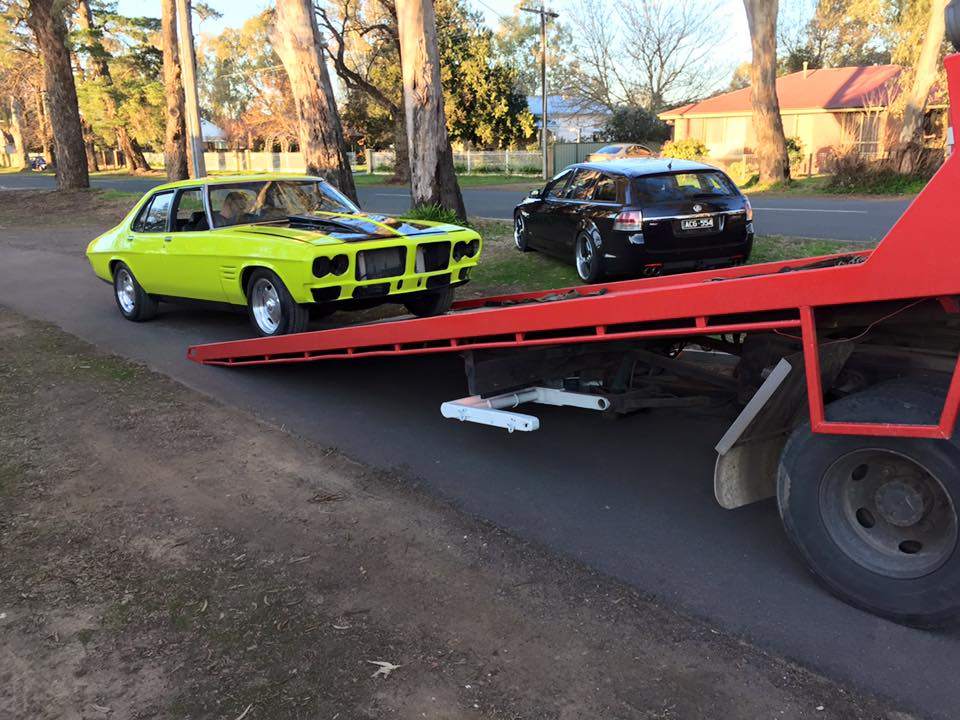 A picture of a Lime green Holden GTS on the Bent and Broke Towing truck